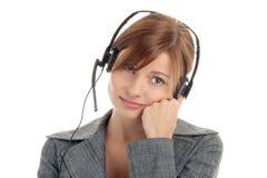 耳机佩带的妇女 免版税图库摄影