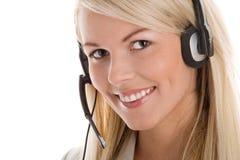耳机佩带的妇女 免版税库存图片