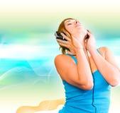 耳机性妇女 免版税库存照片