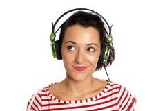 耳机查出的听的音乐妇女年轻人 库存图片