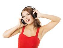 耳机的女孩听到音乐的 妇女portr 免版税库存照片
