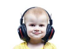 耳机的女孩听音频的 免版税图库摄影
