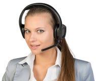 耳机的女实业家 免版税库存图片