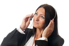耳机的妇女 库存图片