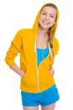 耳机的微笑的少年女孩 免版税图库摄影