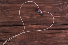 从耳机的心脏 库存照片