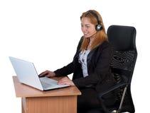 耳机膝上型计算机妇女 免版税库存照片
