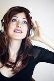 耳机高查出的关键纵向妇女 库存图片