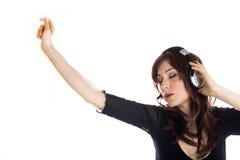 耳机高查出的关键纵向妇女 免版税图库摄影