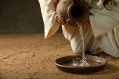 耶稣倾吐的水 免版税图库摄影