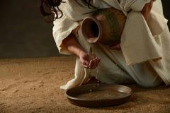 耶稣倾吐的水 免版税库存图片