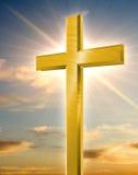 耶稣受难象金黄发光 图库摄影