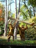 耶稣在卢尔德,法国运载发怒雕象 图库摄影