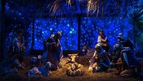 耶稣在圣诞节照明设备帽子的神装饰 库存图片