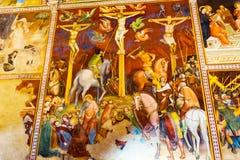 耶稣基督十字架中世纪壁画教会圣吉米尼亚诺托斯卡纳 免版税图库摄影