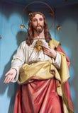耶稣基督的心脏被雕刻的雕象从19的 分 图库摄影