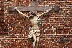 耶稣基督迫害了一个古老木雕塑 库存照片