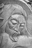 耶稣基督迫害了(一个古老木雕塑) 图库摄影