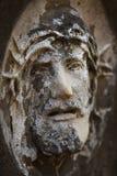 耶稣基督铁海棠的面孔古色古香的雕象 图库摄影