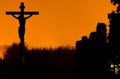 耶稣桔子天空 免版税库存图片