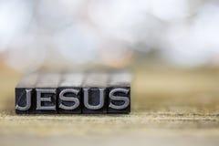 耶稣概念葡萄酒金属活版词 库存照片