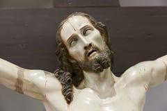 耶稣的面孔迫害了 图库摄影