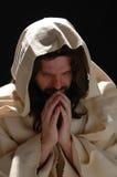 耶稣纵向祷告 图库摄影