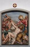 耶稣被钉牢对十字架,第11个苦路 免版税库存图片