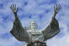 耶稣雕象保佑 库存图片