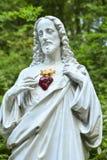 耶稣雕象有心脏的 库存照片