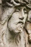 耶稣面对雕象 图库摄影