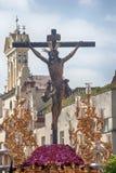 耶稣死在十字架的,圣周在塞维利亚,小狗的团体 免版税库存照片