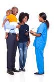护士非洲人家庭 库存图片