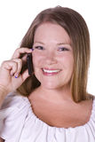 聊天的电话微笑的妇女 库存图片