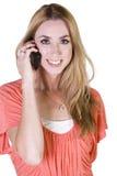 聊天的电话微笑的妇女 免版税库存图片