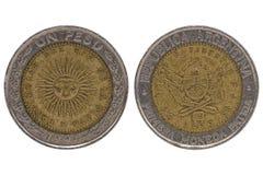 联合国比索在白色背景的阿根廷硬币 免版税图库摄影