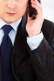 联系生意人接近的移动电话  免版税图库摄影