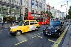 聘用其启用的光伦敦出租汽车 免版税库存照片