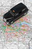 聘用其启用的光伦敦出租汽车 免版税图库摄影