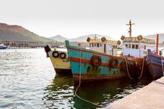 聘用的小船在海 库存照片