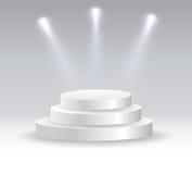 聚光灯照亮的圆的指挥台 免版税库存照片
