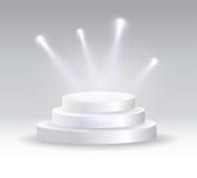聚光灯照亮的圆的指挥台 库存照片