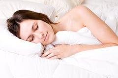 聪慧的休眠的妇女 库存照片