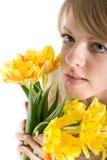 聪慧的女孩性感的tulps黄色 免版税图库摄影