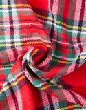 聪慧的苏格兰人被检查的织品 库存图片