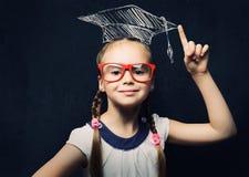聪明的女小学生 免版税库存图片