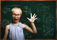 聪明的女小学生 库存图片