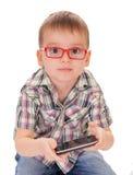 聪明的孩子作用巧妙的电话 库存照片