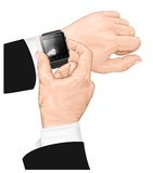 聪明的手表姿态。 免版税库存照片