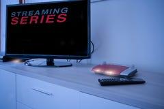 聪明的电视被连接到互联网调制解调器网络 免版税库存图片